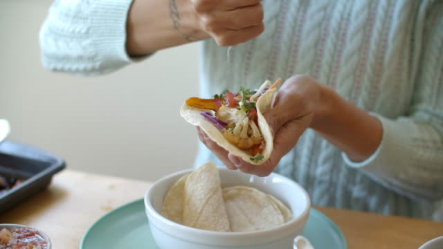 young woman making vegan tacos at home - meal stock videos & royalty-free footage