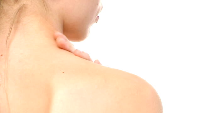 young woman massaging her shoulder