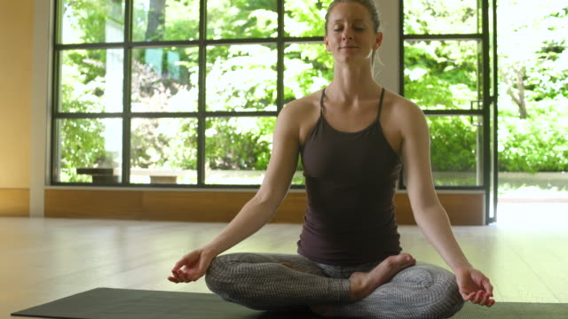 Young woman meditating by herself