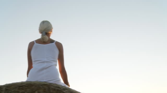 HD STEADY SHOT: Young Woman Meditating In Nature