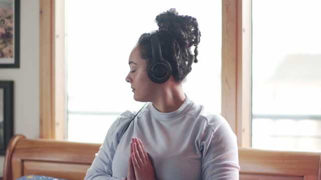 a young woman meditating - lotus position stock videos & royalty-free footage