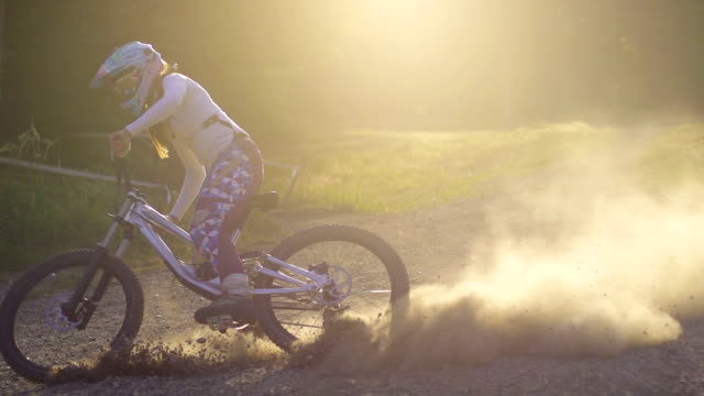 young woman mountain biking - motorcycle biker stock videos & royalty-free footage