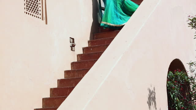 young woman moving down from stairs, nahar singh palace, haryana - haryana stock-videos und b-roll-filmmaterial