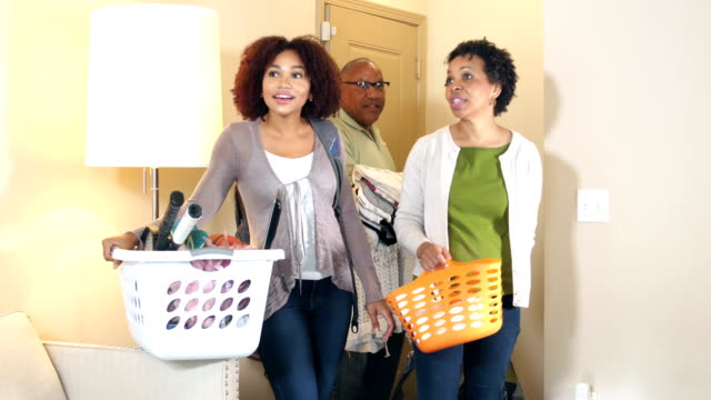 young woman moving into new home, parents helping - adult offspring stock videos & royalty-free footage