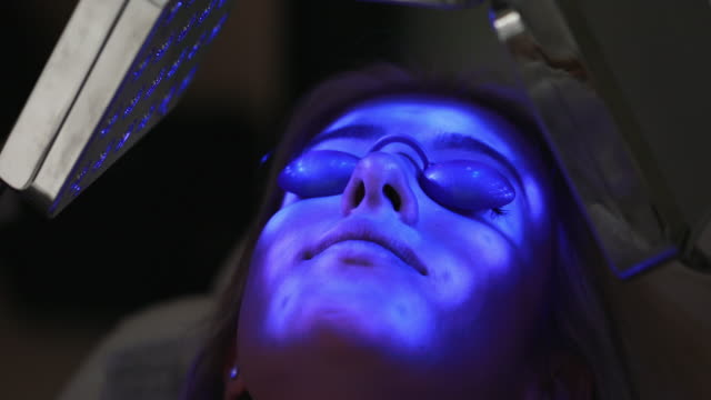 young woman on a anti aging treatment at a spa - anti aging stock videos & royalty-free footage
