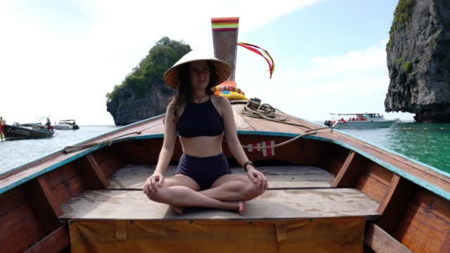 young woman on a longtail boat in thailand, phi phi island - phi phi islands stock videos & royalty-free footage