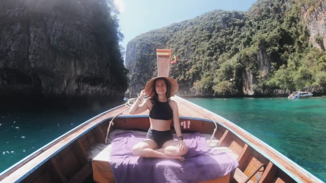 young woman on a longtail boat in thailand, phi phi island - thailand stock videos & royalty-free footage