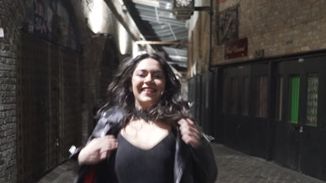 a young woman on a night out running towards the camera. - leather jacket stock videos & royalty-free footage
