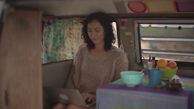 Young woman on a road trip in her camper van
