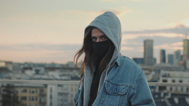 young woman on a rooftop. enjoying the sunset during pandemic - jeans stock videos & royalty-free footage