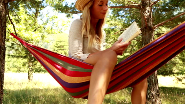 young woman on hammock in summer reading a book - ticino canton stock videos and b-roll footage