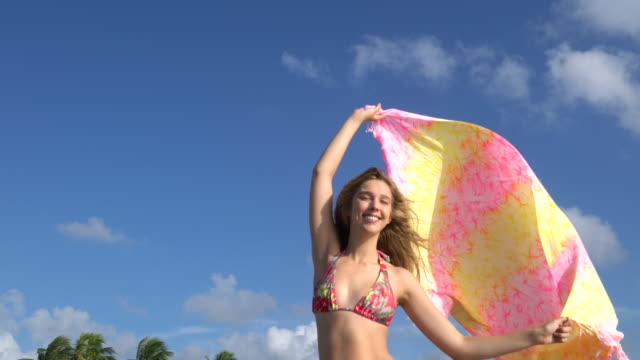 young woman on the beach - sarong stock videos and b-roll footage