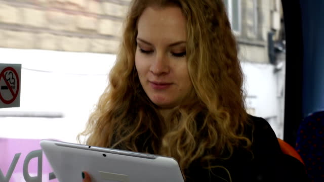 Young woman On the bus with a Digital Tablet
