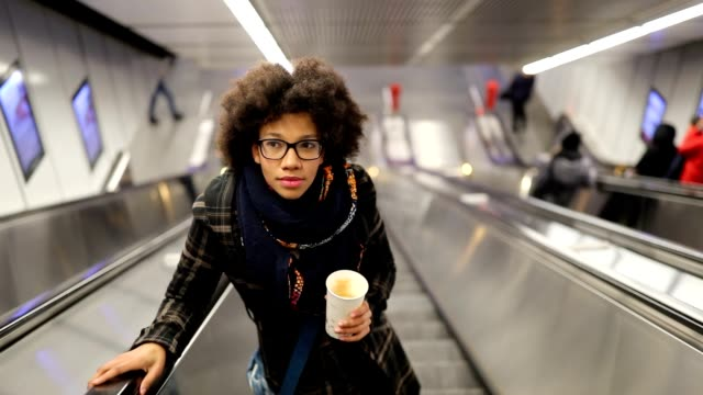 young woman on the escalator - young women stock videos & royalty-free footage