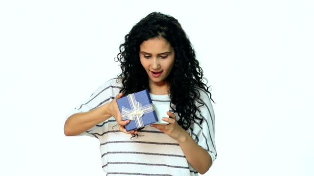 ms young woman opening gift - war in afghanistan: 2001 present stock-videos und b-roll-filmmaterial