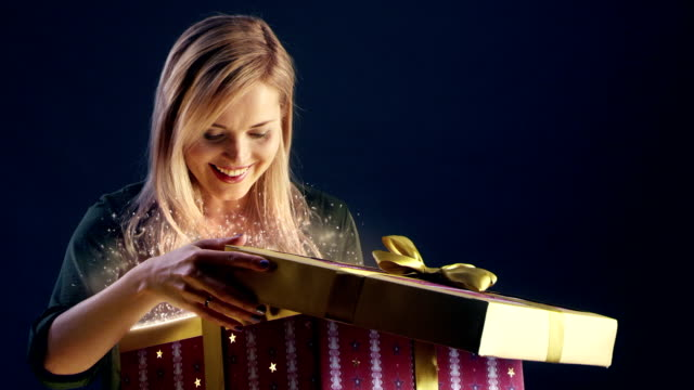 young woman opening magical christmas gift - gift stock videos & royalty-free footage