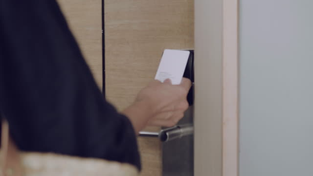 young woman opening security door with access card - - hotel stock videos & royalty-free footage