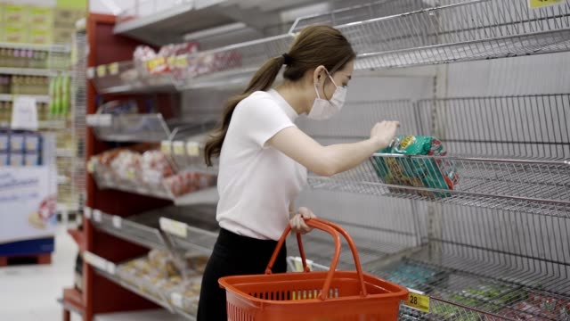 young woman or girl wearing a facial mask buying food in supermarket - market retail space stock videos & royalty-free footage