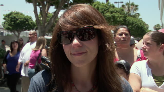 young woman outside the staples center before the michael jackson memorial service speaking about being in los angeles to pay tribute to michael... - media interview stock videos and b-roll footage