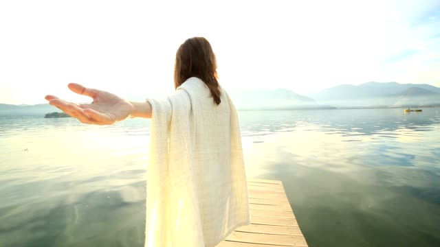 young woman outstretching her arms on wooden pier - jetty stock videos & royalty-free footage