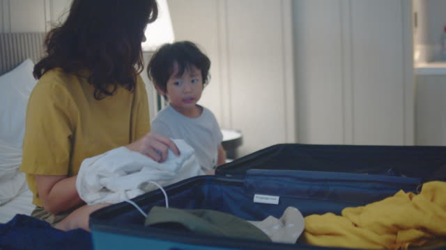 young woman packing suitcase - packing stock videos & royalty-free footage