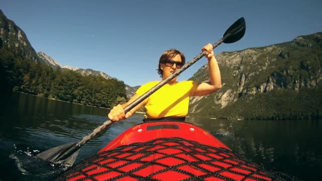 HD: Young woman paddling.
