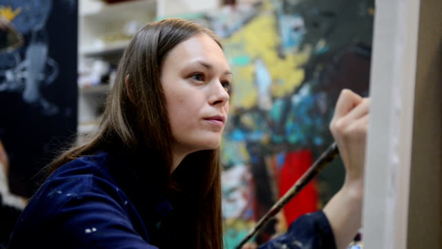 young woman painter in the art studio - painter artist stock videos and b-roll footage