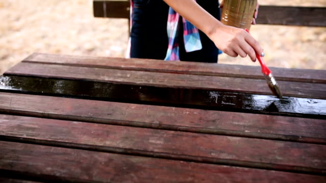 young woman painting the table in the park - wood material stock videos & royalty-free footage