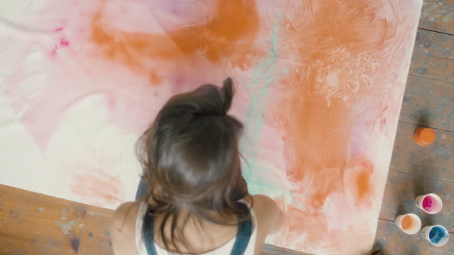 young woman painting - immaginazione video stock e b–roll
