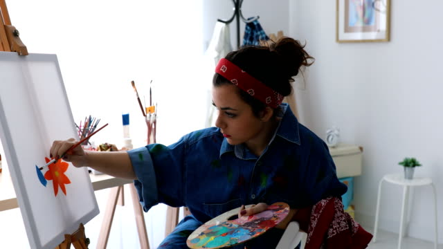 young woman painting with oil paint - passione video stock e b–roll