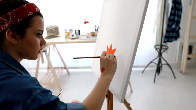 young woman painting with oil paint - canvas fabric stock videos and b-roll footage