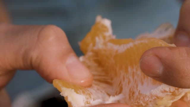 young woman peeling orange - ascorbic acid stock videos & royalty-free footage