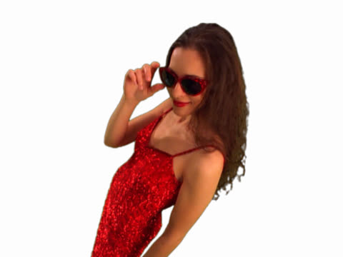 young woman peering over sunglasses - formato video mpeg video stock e b–roll