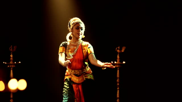 ms young woman performing bharatanatyam dance on stage / india - three quarter length stock videos & royalty-free footage