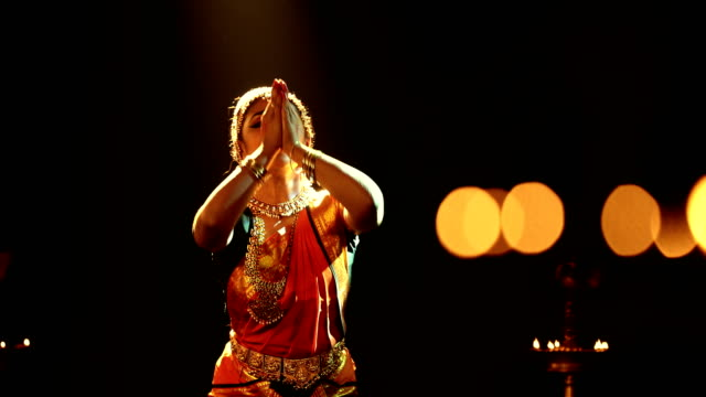 ms young woman performing bharatanatyam dance on stage / india - sari stock videos and b-roll footage