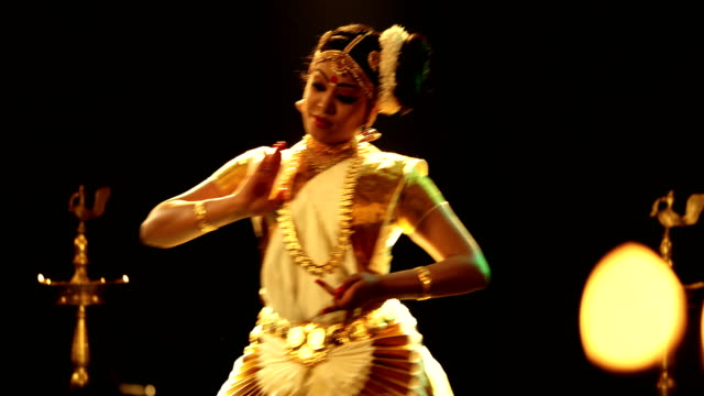 ms young woman performing mohiniyattam dance on stage / india - three quarter length stock videos & royalty-free footage