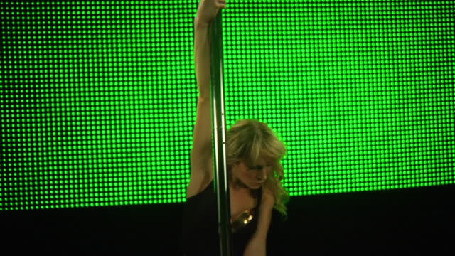 MS TU TD SLO MO Young woman performing pole dance on stage / London, UK