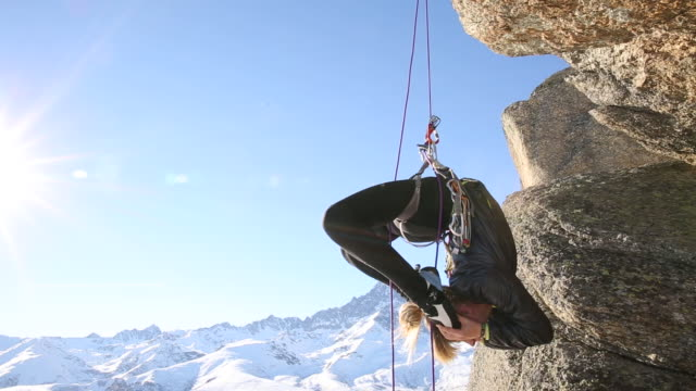 young woman performs 'vertical' yoga moves, on climbing rope - climbing rope stock videos & royalty-free footage