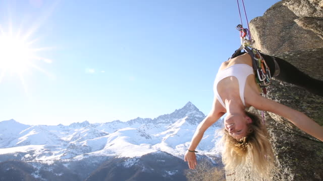 young woman performs 'vertical' yoga moves, on climbing rope - upside down stock videos & royalty-free footage