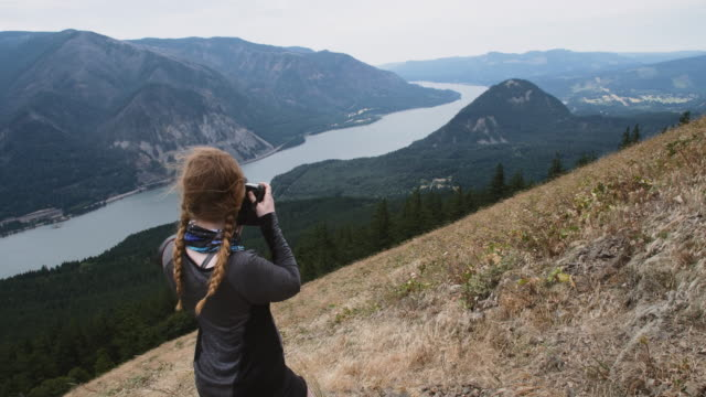young woman photographing at dog mountain, washington usa - oregon us state stock videos & royalty-free footage