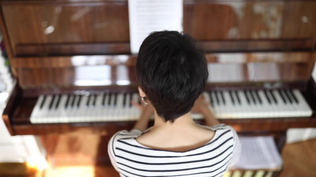young woman pianist playing piano at home - soloist stock videos & royalty-free footage