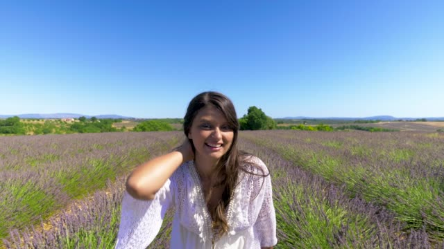 Young woman Playful in lavender field.