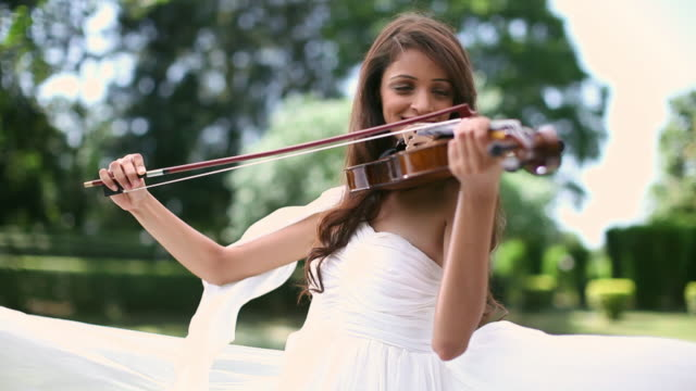 young woman playing a violin - shoulder ride woman stock videos & royalty-free footage