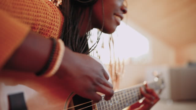 young woman playing acoustic guitar - composer stock videos & royalty-free footage