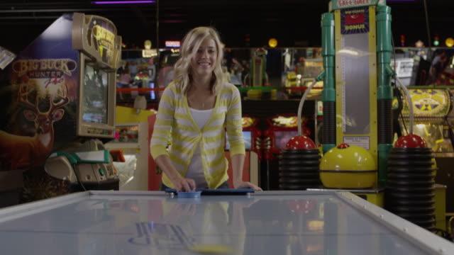 ms young woman playing air hockey, orem, utah, usa - orem utah stock videos & royalty-free footage