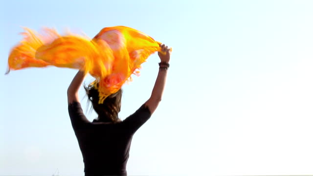 young woman playing at the beach - パレオ点の映像素材/bロール