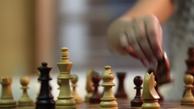 young woman playing chess, delhi, india - chess stock videos & royalty-free footage
