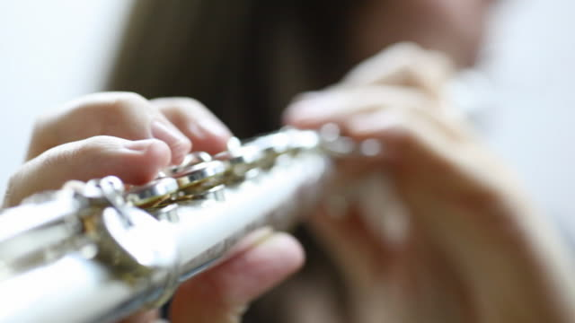 young woman playing flute - musical instrument stock videos & royalty-free footage