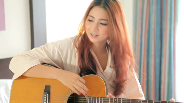 young woman playing guitar - singer stock videos & royalty-free footage