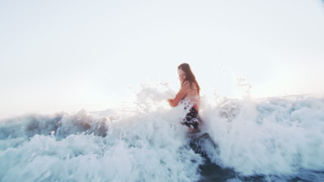 young woman playing in the waves - 30 34 years stock videos & royalty-free footage